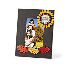 Love this colorful fall photo display with Autumn Blessings Soul Blossom Magnet and Oak Leaf Magnet Set! Change out magnets and photos for a year round display.  Sunflower Magnet, Leaves and Magnetic Frame from Embellish Your Story by Roeda.