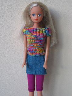 Top and straight, short skirt for Barbie. Photo shows only the top.