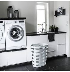 Washer and dryer on a small cabinet for laundry detergent and the like. - Washer and dryer on a small cabinet for laundry detergent and the like. Modern Laundry Rooms, Laundry In Bathroom, Küchen Design, Home Design, Laundry Room Inspiration, Metal Building Homes, Small Cabinet, Laundry Room Storage, Laundry Room Design