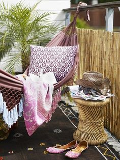 A cozy space for small balcony. Hammock!