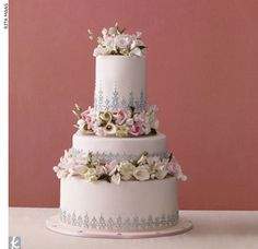 3 tier dusty pink cake accented with silver dragees and sugar flowers
