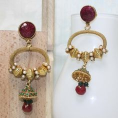 Oval shape jhumki in polki work carved in stone and faux pearl