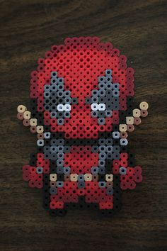 Perler and Artkal fuse bead Deadpool by PkmnMasterTash/pkmnmastertash-creations/Natasha Lazaravich. Original sprite from http://cx-asuka.deviantart.com/art/Poke-Deadpool-sprites-171781161