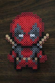 Perler and Artkal fuse bead Deadpool by PkmnMasterTash/pkmnmastertash-creations/Natasha Lazaravich. Original sprite from http://cx-asuka.deviantart.com/art/Poke-Deadpool-sprites-171781161