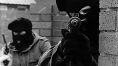 The Troubles Thirty years of conflict in Northern Ireland, 1968 - 1998. Two masked gunmen (Pacemaker Press Intl)