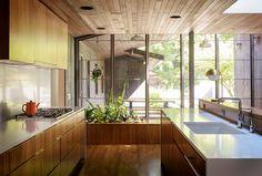 PentalQuartz countertops in polished Super White, flat-sawn eastern walnut cabinets