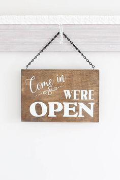 Business Open/Closed Sign: THIS SIGN: *Measures approximately 6 x 11 or 8 x 11.5 (Choose your size) *Comes with jute or chain for easy hanging *Is done with a stain finish and Bright White for the text. (May also choose black for the text.) (The back is finished as well.) The front of this sign is Come in, were open and on the reverse side Sorry, were closed. Great sign for any business to hang on the door or window. After painting I add a soft clear wax to protect it and buff it lightly ...