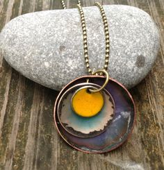 Enameled copper and silver with purple, ocean blue and mustard yellow with brass chain