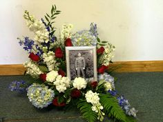 Red, white & blue arrangement around a memorial picture