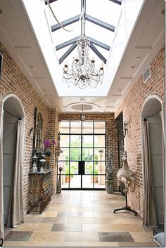 Raised roof with the large skylight, arched brick doorways, closed off with linen curtains. Beautiful.