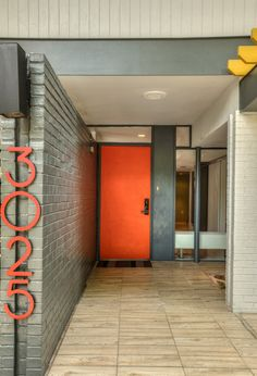 Modern Front Door with Modern House Numbers, exterior tile floors Exterior Tiles, Exterior House Colors, Modern Exterior, Exterior Paint, Orange Front Doors, Orange Door, Front Door Colors, Orange House, Entrance Design