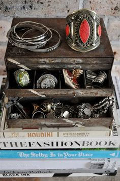 old tool box (or maybe tackle box) used to as a jewelry box with a fabulous vintage collection inside