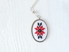 Hand embroidered necklace Ukrainian ornament red and black. $22.50, via Etsy.