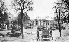 Abandoned vehicles in the town square of Bastogne.
