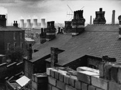 Shirley Baker, Cooling towers through rooftops, Manchester, 1966.