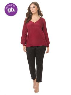 LIKE = V neck, doesn't cling, no buttons, interesting sleeve.  Olivia Top In Burgundy