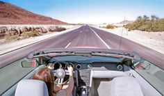Travel the Pacific Coast Highway in a convertible with Jackie O sunglasses and a scarf in my hair!