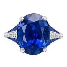 Sapphire and diamond ring, centering on an oval-shaped sapphire weighing 10.10 carats, flanked by tapering rows of french-cut sapphires and pavé diamonds, mounted in platinum.