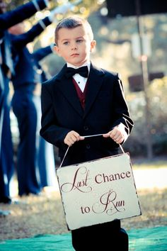 I'm picturing one sign saying here comes your bride then this. Oh so cute and funny :)