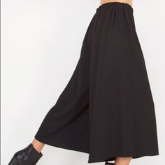 Available in XS,S,M,L. NWT. Culotte Pants Trends are easy to do but before you jump in head first, start with basics. I love the culotte trend but I'm not sure if its going to last or if I'll love the way it will look on me. My only style rule for these pants is wear with a high heel. If you love this trend, this is a great piece to incorporate into your wardrobe with little to no risk!  Product Info: Wide leg culotte pant with a stretch band at waist.100% Polyester Pants Capris