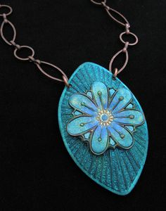Colgante flor azul