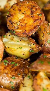 Garlic-Herb & Parmesan Roasted Red Potatoes ~ There is a ton of flavor from all of the garlic and herbs, and the Parmesan sort of crusts over the potatoes, which tastes amazing... Perfection!