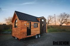 "A tiny house, named ""The Hiatus"", made in Bend Oregon, by Tongue & Groove Tiny Homes.A rustic tiny house on wheels with a bright, modern interior."