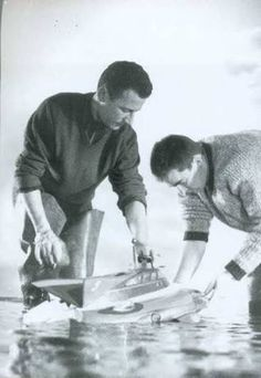 Derek Meddings (left) attending to the Stingray model.