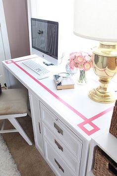 Painting a design ontop adds a design element of its own and takes an otherwise plain desk top and ties it in beautifully with the room.