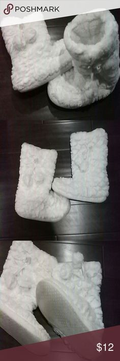 Winter soft bootie slippers Like new! Super soft winter boot slippers with pom poms! Worn just a few times. Size reads 5/6 Shoes Slippers