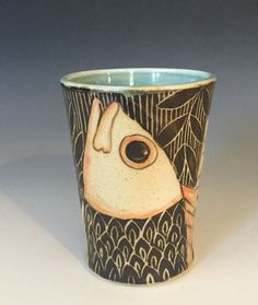 This stoneware wheel thrown sgraffito Fish tumbler was made in my studio in the mountains in Colorado. Makes a great homemade gift idea for men.