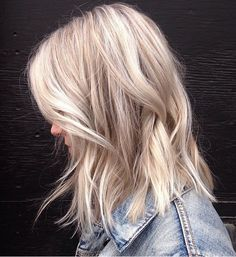 A long bob with textured waves and cool blonde tones. Perfection. Color by Patricia J.