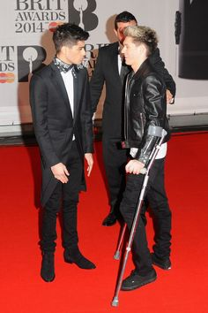 And Niall waddled along in these crutches.*