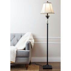 Place this distinctive lamp in a place of honor in a well-appointed traditional foyer to serve as a focal piece. Display the lamp without worry, safe in the knowledge that its stylized geometric footi