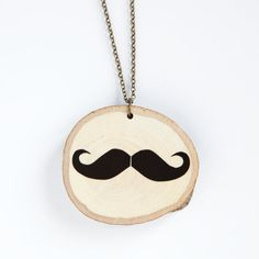 depeapa  Mustache - illustrated wooden necklace. $25.00, via Etsy.