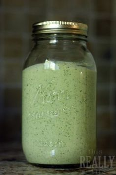 Creamy Cilantro Dressing - My new favorite dressing. I used it on romaine with grape tomatoes, avocado, corn, sunflower seeds and tortilla strips.