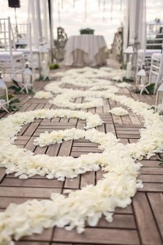 Ivory rose petals in a scroll pattern will go down the ceremony aisle.