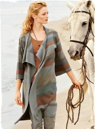 Draping the body in weathered hues of driftwood, clay and sea-glass pima, our fine gauge knit cardigan is styled with 3⁄4-kimono sleeves and a sculptural waterfall placket.