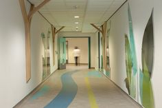 leaf inspired wall and floor graphics make corridors a more inviting space Church Interior Design, Interior Design Services, Children's Clinic, Turquoise Kitchen Decor, Floor Graphics, Hospital Design, Clinic Design, Hallway Designs, Childrens Hospital