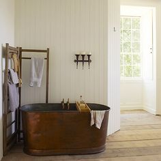 There's something undeniably luxurious about a deep, stand-alone tub.