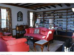 Formal living room has lovely details including fireplace and built-in bookcases. Find this home on Realtor.com