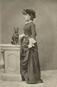 "Empress Elisabeth of Austria,in riding habits and with her pet dog in the  1860s. ""AL"""