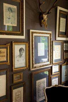 Dark grey walls, variety of frames