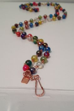 """Color: Multi-colorMaterials: copper wire, glass beads Length: 40"""" aroundThis lanyard can transform into an E"""