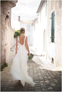 beautiful backless weddingdress pictured on the streets of France via www.frenchweddingstyle.com #weddingdress
