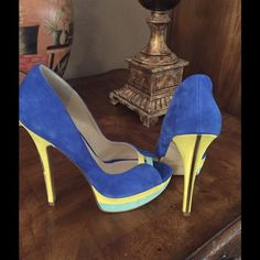 Enzo Angiolini platform heels Stunning Enzo Angiolini reach suede platform high heeled pumps. Gold trim on the back of a heel. Beautiful colors-Royal blue, sun yellow, mint and gold make them suitable with any fancy outfit. Worn once. Hate to let them go, but they are just too high for me. Enzo Angiolini Shoes Heels