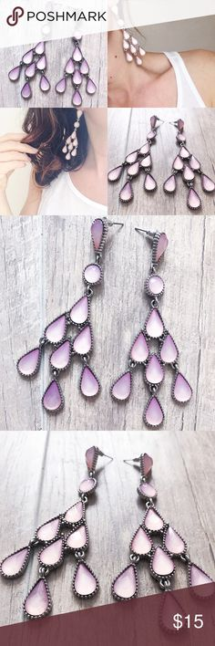 Tear drop earrings✨ Beautiful tear drop earrings!8 pink tear drops dangle from your ears! 1 round pink stone! Surrounded by a vintage silver design! Boutique bought! ✨make an offer! No trades thank you! Jewelry Earrings