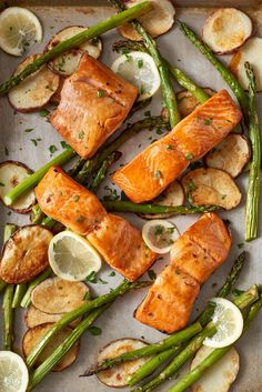 Yes, really — it will all happen in under 20 minutes. We're talking about this sheet pan salmon with potatoes and asparagus. This dinner shows you how quick it can be to put a salmon dinner on the table. The recipe calls for lemn juice, garlic, olive oil, asparagus, red potatoes, skin-on salmon fillets and ground pepper.