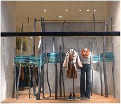 """Elisa Werbler's """"Harvest"""" window installation for Anthropologie.  Birch logs, thread."""