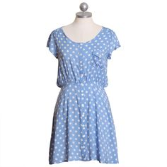 Look... more polka dots! This would look really cute with a brightly colored belt!